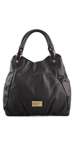 Marc by Marc Jacobs Classic Q Francesca Tote. Just bought it last week. LOVE it! It goes with everything, lets me fit all my crap in it, & the pebbled leather is extra durable...