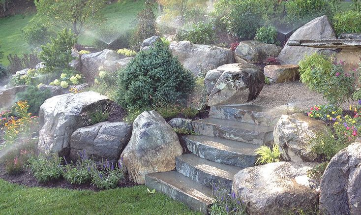 Add stylish touches to your outdoor space with these stone landscaping ideas: ideas for paths, patios, backyard waterfalls, decorative rock seating and more