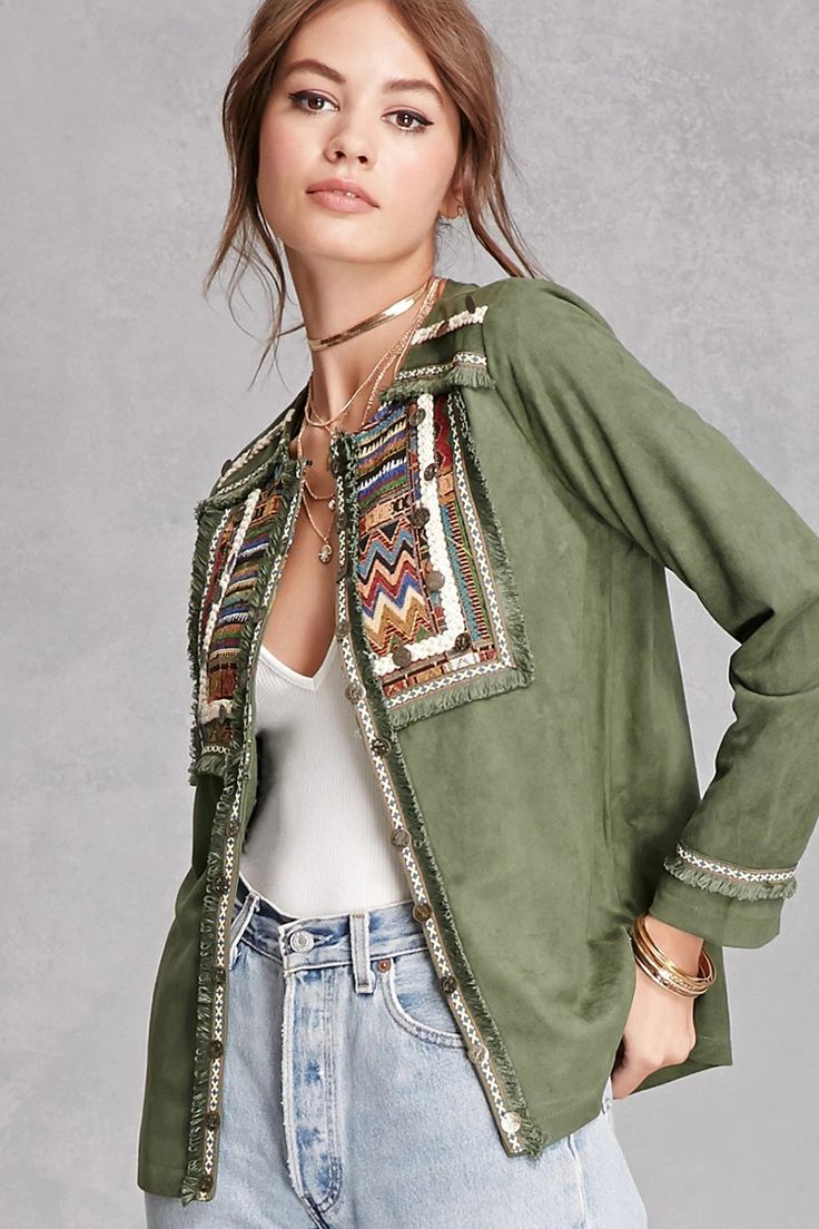 A faux suede jacket by Cherry Paris™ featuring geo-patterned paneling throughout, burnished medallion accents, braided trim, thread trim, woven lining, and long sleeves.