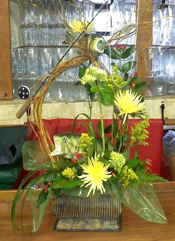 Mushroom fish, a rod and rell and flowers all in the same container. A perfect tribute for that special fisherman. $75.00