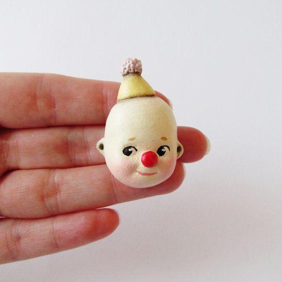 Kewpie Clown Brooch  Paperclay Doll Face Pin by DottieDollie