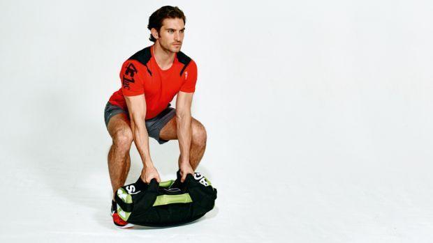 Full-body sandbag workout