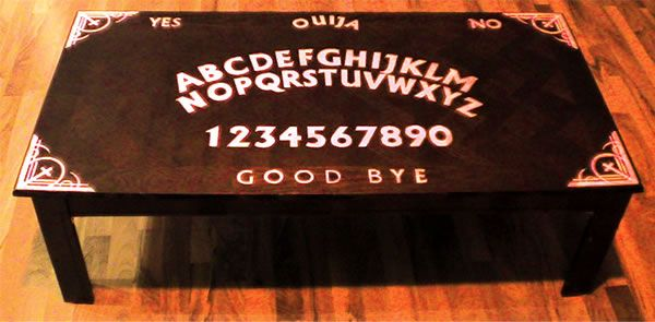 Ouija Boards freak some people out. If you're not one of those people and have ever wanted to conjure spirits over your morning coffee or summon a demon while enjoying some tacos, then these tables are for you.  Some  of these Ouija tables you can purchase, some you can't, and some have instructions on how to make your own. Just follow the links. Do you have a scary Ouija story? Please share it in the comments below!    via    Purchase this table HERE.    via     Learn how to make this table…