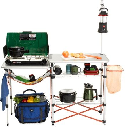 REI Camp Kitchen With dedicated spots for all your cooking supplies, this camp kitchen keeps you organized so you can spend less time searching for a spatula and more time hiking, biking and relaxing with friends.
