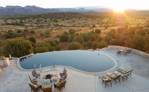 infinity kidney shaped pool design fire pit deck chairs mountain view