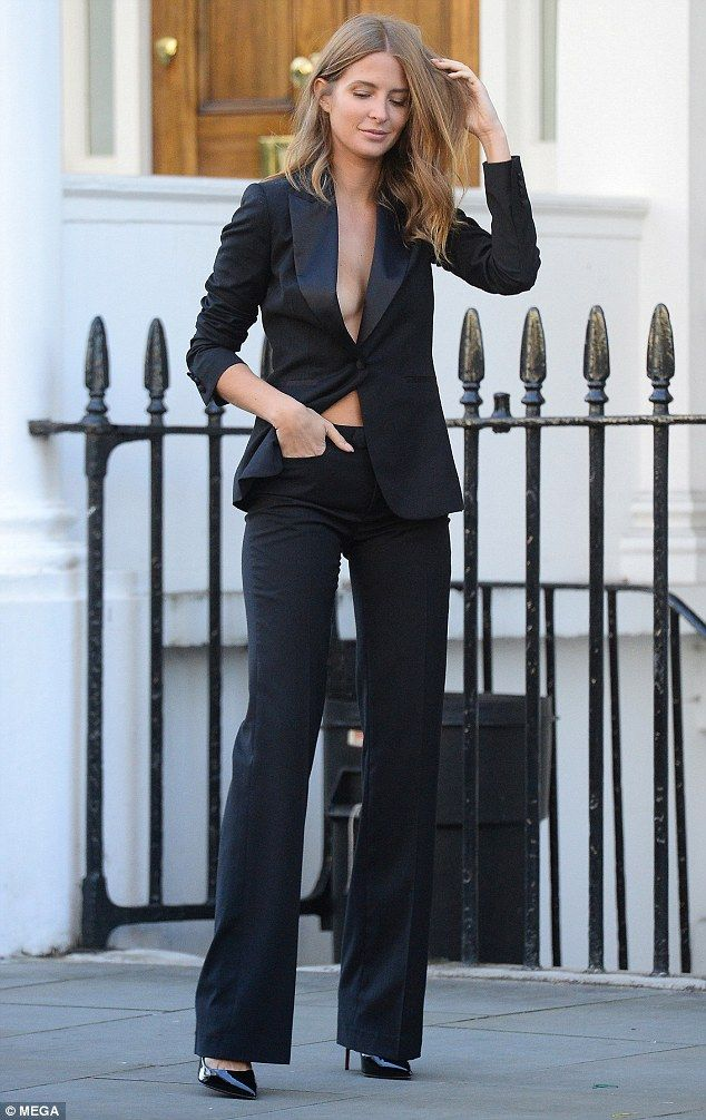 Fresh from Paris:Millie Macintosh was still in the catwalk mood as she stepped out in London on Sunday, going braless underneath a tailored suit