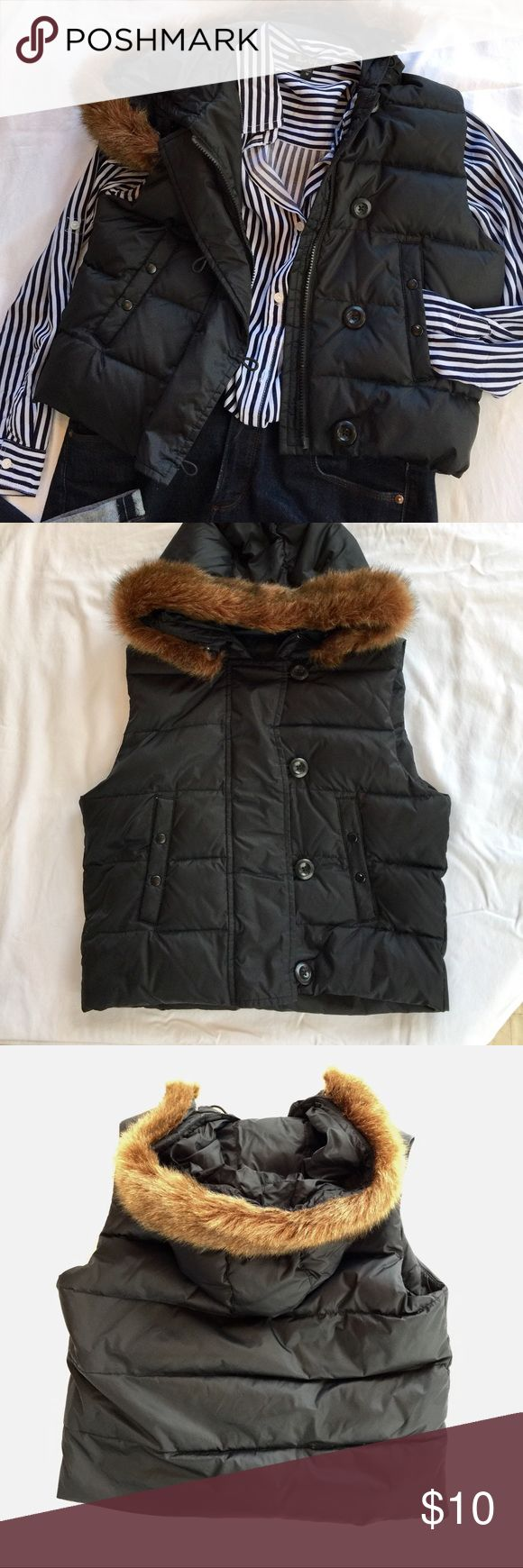 """GAP Short Black Down Vest Very cute GAP size M Black Down Vest. Non-removable hood has a removable imitation fur trim. Approximately 19"""" long. Falls to natural waist line. Zippered front with fabric overlap that buttons closed. Pockets on each side snap closed. One interior pocket with Velcro closure.    Shell 100% nylon. Lining 100% poly. 75% down filling. There is a tiny white mark on one of the pocket snaps- Black marker may cover it? See last pic. No Trades GAP Jackets & Coats Vests"""