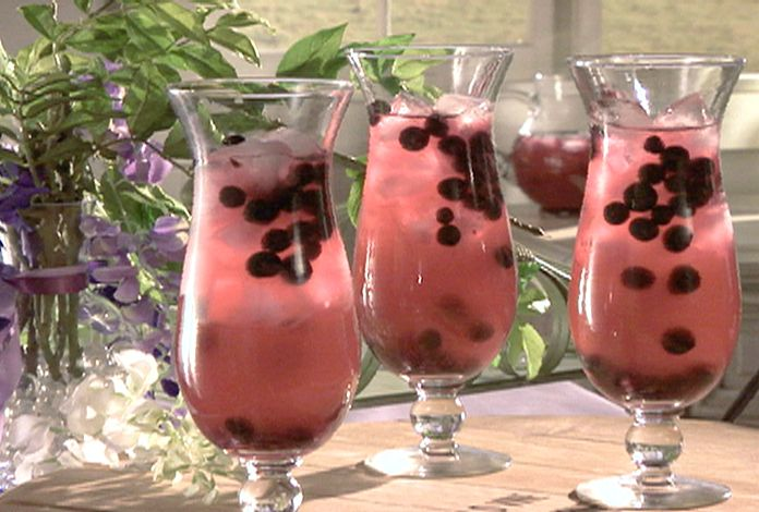 Berry Sangria - 1 bag frozen berries, 1 can pink lemonade concentrate, 1 can sprite, 1 bottle cheap white wine, 1/2 cup brandy.