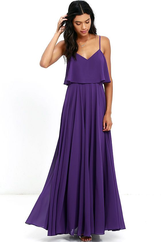 We're absolutely love struck over the Love Runs High Purple Maxi Dress! Purple woven poly falls from adjustable straps into a tiered, triangle bodice above a cascading maxi skirt full of volume. Hidden side zipper.