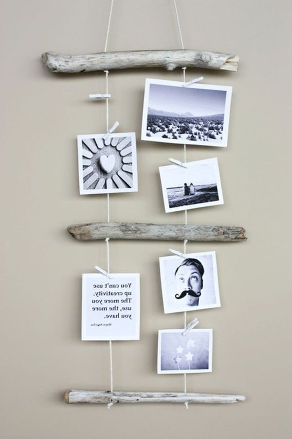 hängende fotos und stöcke aus holz als wanddekoration - Zeit für Kunst – 48 Wanddekoration Ideen