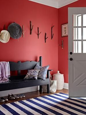 Why hide your personality? Greet guests with a foyer painted an inviting rustic red.