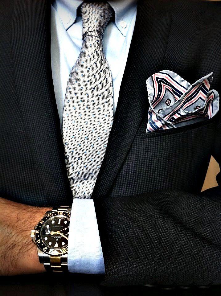 Navy jacket, light blue button down shirt, silver tie