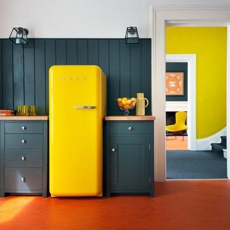 Bright yellow fridge. Interesting - yellow and grey?