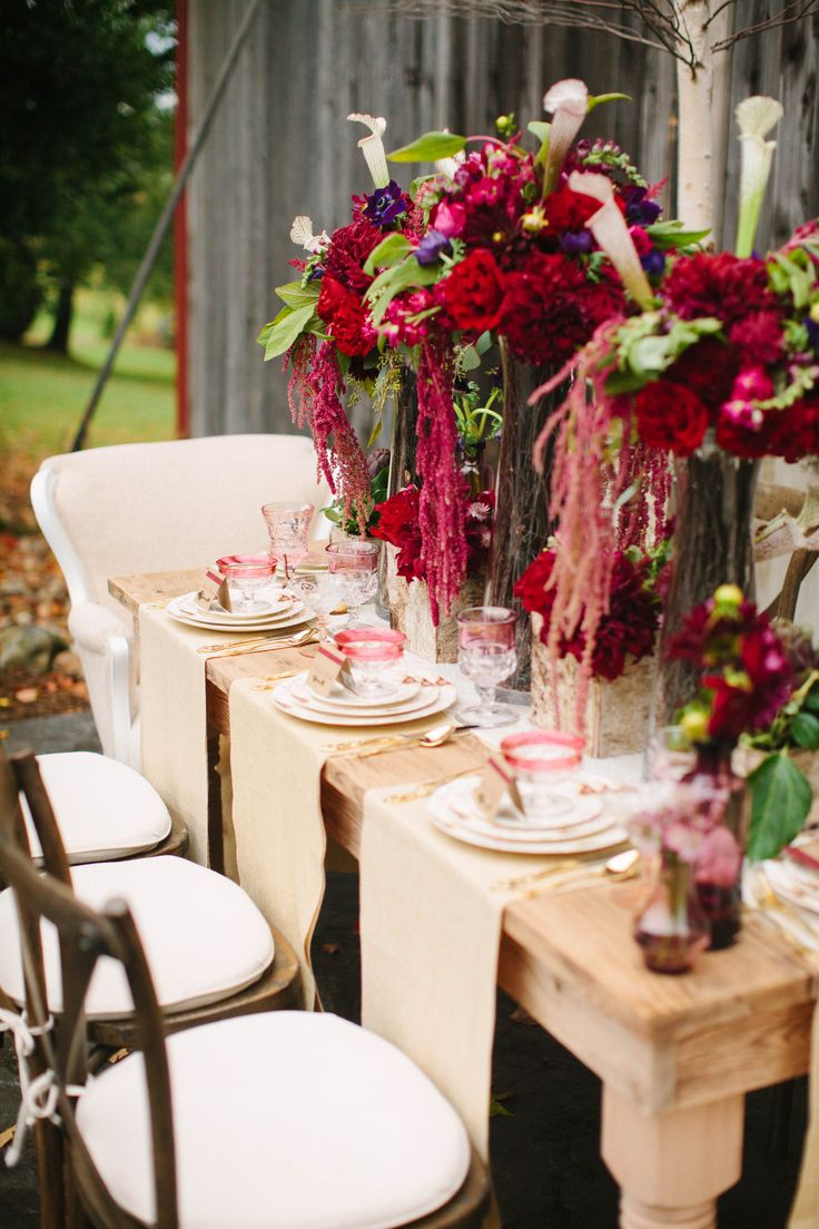 We love that brides are understanding that Rustic does not have to mean burlap. This stunning table scape has gorgeous color and texture that have been trending this year!
