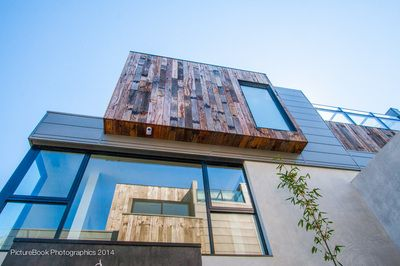 Recycled Ironbark sleepers sourced from Queensland railways were used on the exterior of the building to add rustic charm to the sleek, contemporary architectural design at around 175mm x 25mm.