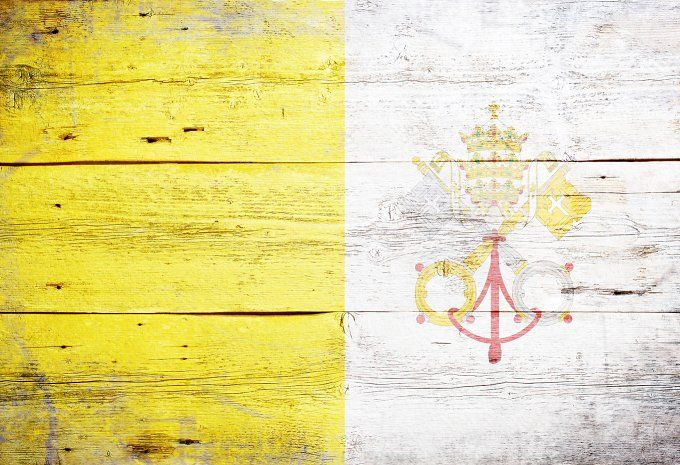 #Flag of Vatican City  Flag of Vatican City painted on grungy wood plank background