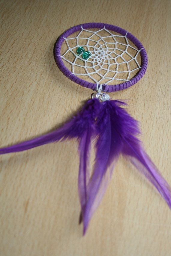 Purple trim dream catcher with purple feathers, white web and teal glass bead finish 7cm diameter dreamcatcher hand made on Etsy, £5.59