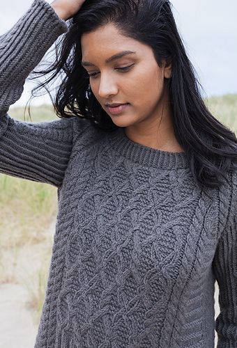 A feminine interpretation of the traditional Gansey pullover, this design incorporates several vertical and horizontal details to create a modern version of the time-honored classic. It is worked in pieces from bottom up.