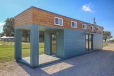 Tiny home covered in blue wood paneling