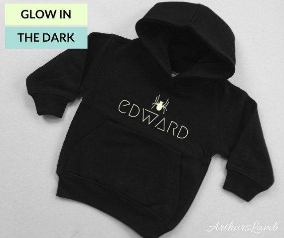 Spiders are much loved graphic logos now days, but especially at Halloween!! And with this personalised Glow in the Dark Spider Icon hoodie you are sure to stand out!! So whether you are looking for a something to wear when you go out to trick or treat or a Halloween gift, this sweater/jumper personalised with any name will be a much loved addition to the spooky day!! When ordering, please note the name required in Comments to Seller box during checkout. These Black Hoodies with their Glow…