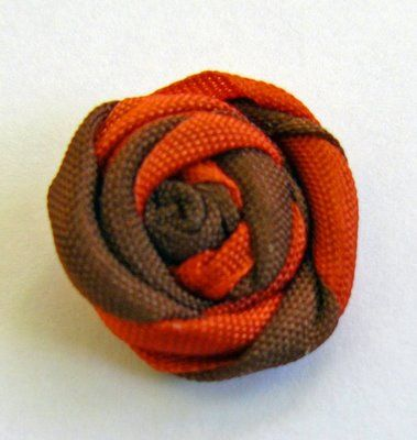 Tutorial for ribbon roses  All you need is ribbon,craft glue and some scissors.