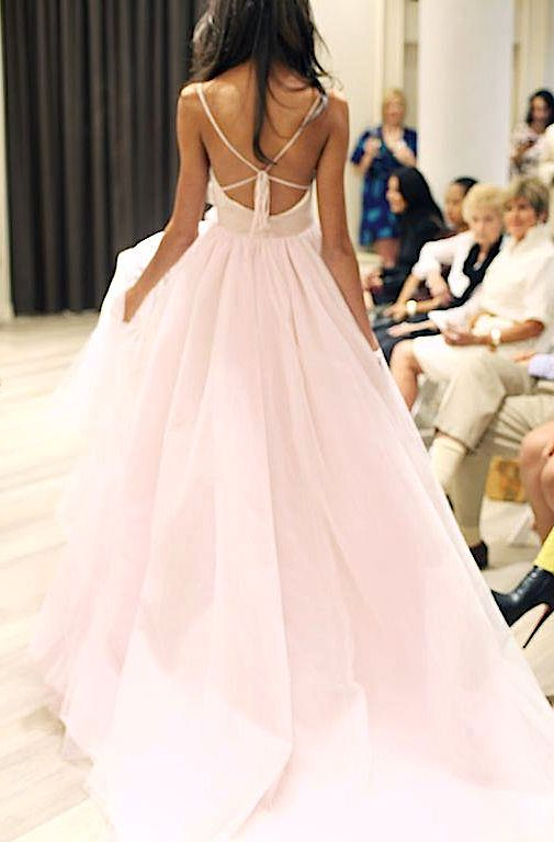 If this was more white then pink it would be a beautiful beach wedding dress!