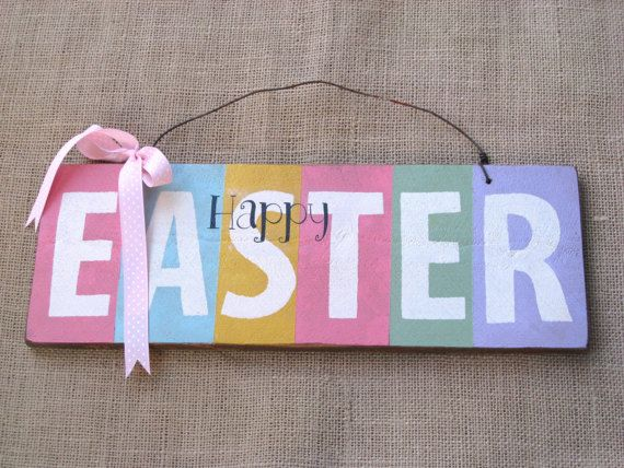 Celebrate Spring and welcome the Easter bunny with this rustic wooden Happy EASTER sign. The sign measures approximately 14 inches long and 5 1/4 inches wide, and is hand-painted on a scrap of 1/2 Cedar wood. Alternating pastel colors form the background for the warm white lettering. The stenciled letters that spell EASTER are hand-cut, and the Happy letters are added with the ink transfer method. The sign is sanded and stained to age it slightly, and the front of the sign is protec...