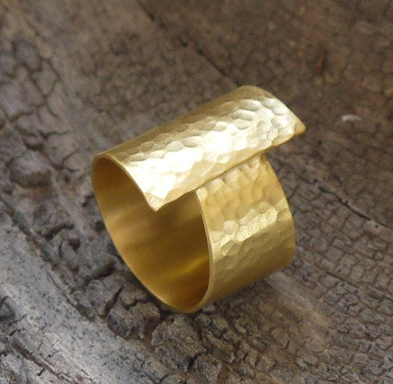 This statement gold ring made of 24K gold plated hammered brass sheet.    Width at the narrowest side 0,39(1cm)  Width at the widest side 1,78(2cm)