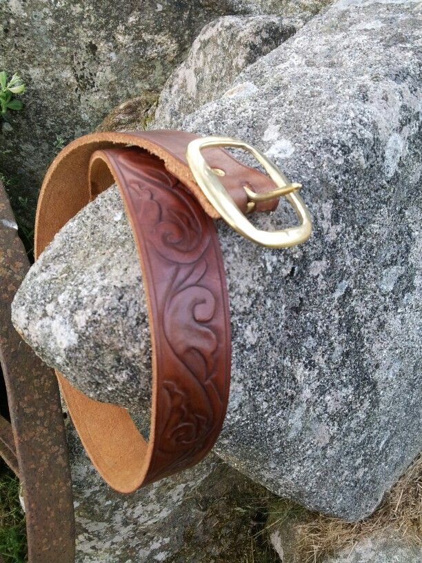 "1.5"" leather belt with carved scroll pattern"