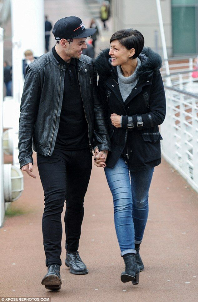 Taking a break: Matt and Emma Willis looked totally loved-up as they wandered around Manchester city centre on Sunday morning