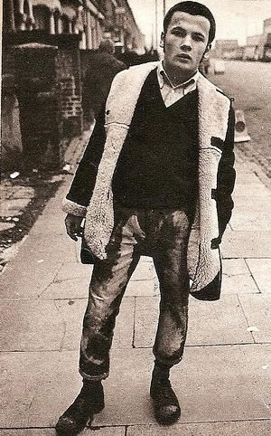 60's skinhead with bleached jeans to look faded; sheepskin. Via Mod Generation; original source unknown.