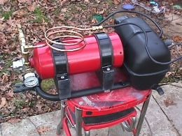 Fire Extinguisher Air Compressor - Homemade air compressor adapted from a surplus refrigerator compressor and a fire extinguisher tank.