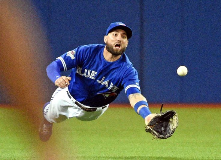 Great grab - Toronto Blue Jays center fielder Kevin Pillar catches a ball hit by Texas Rangers left fielder Josh Hamilton (not pictured) in the fourth inning in game five of the ALDS at Rogers Centre in Toronto on Oct 14. - © Nick Turchiaro/USA TODAY Sports