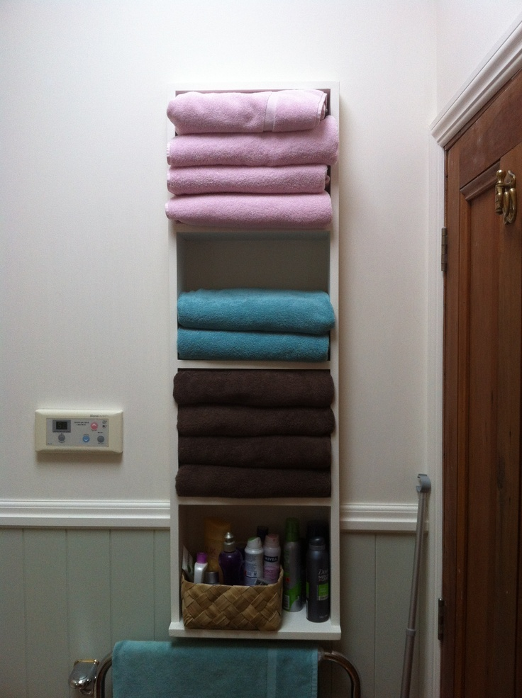 Recessed shelving provides storage for towels behind the door - and close to the shower. Using the wall space meant extra storage - something villas often lack!