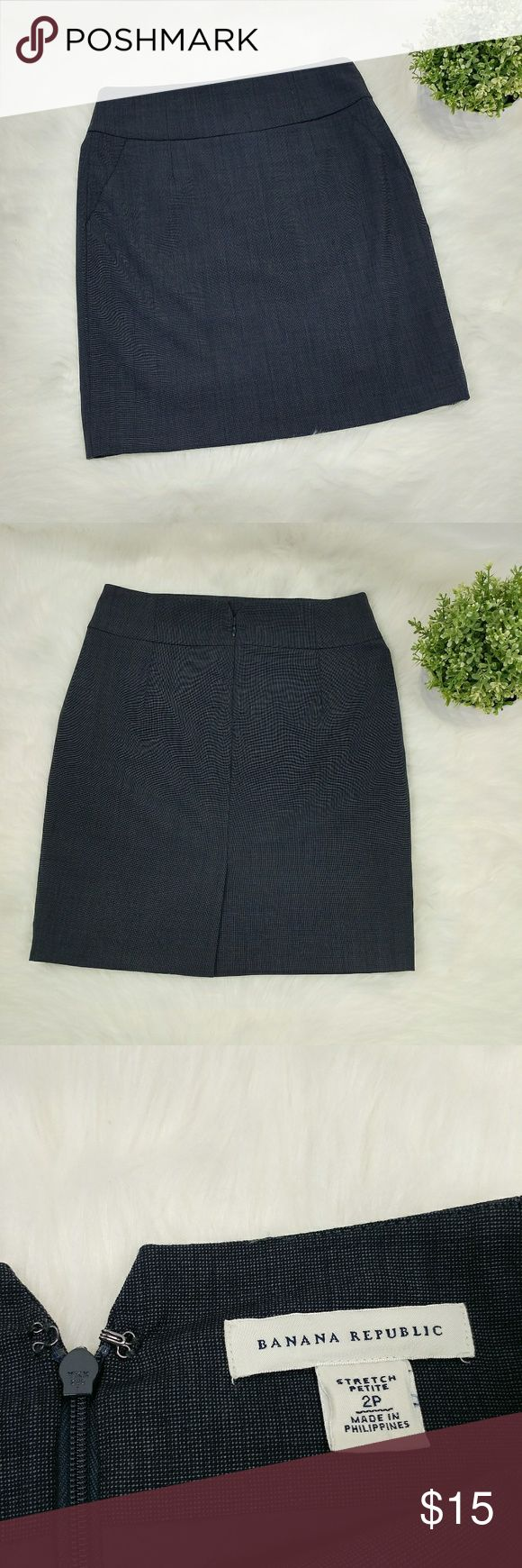 """Banana Republic wool blend navy pencil skirt Banana Republic wool blend career navy stretch pencil skirt Two front pockets that still have the stitching never been undone. Back slit 4 3/4"""" Waist 14"""" flat across Length 19.5"""" Has a tiny flaw at the waist (pictured) Banana Republic Skirts Pencil"""