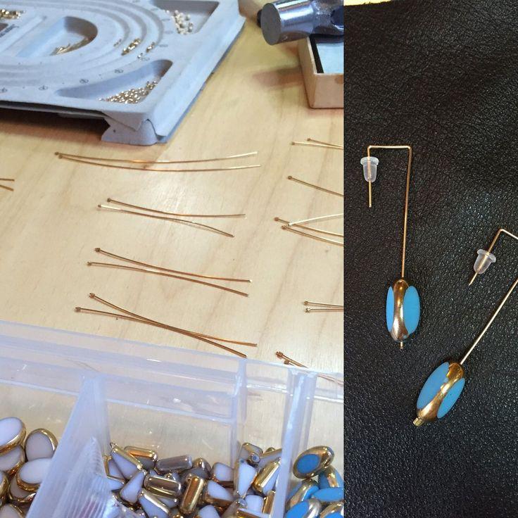 In the studio making ocean 14k stick earrings