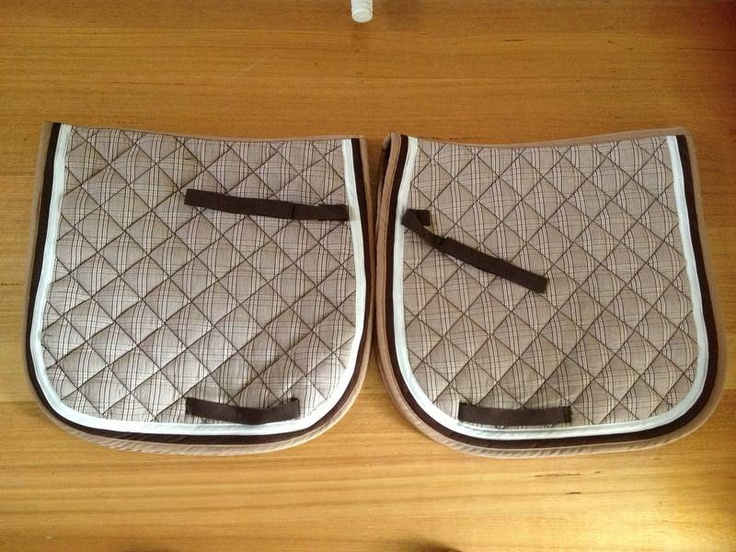 HMK Pony Dressage Saddle Cloths x 2.Hardly used in perfect condition. 25 each.Pick up or post at buyer's expense. One set of matching pony dressage bandages available too.