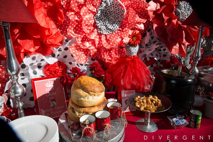 Red, Black and White themed garden birthday party buffet table with giant paper flowers