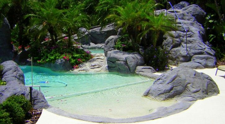 Natural backyard swimming pools rock pool design ideas for Rock pool designs