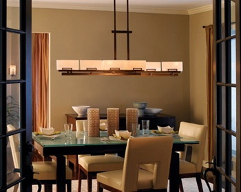 The Surprising Lines And Serene Shadow Bronze Finish Accentuate Comfortable Formality Of This Dining Room Stylish Yet Homey Linear Chandelier