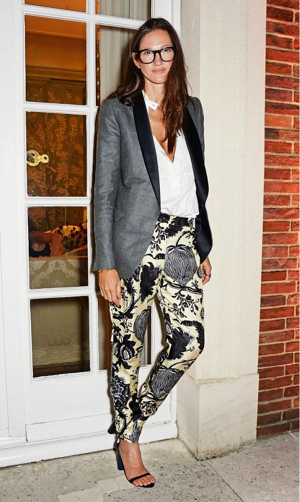 Jenna Lyons steps out in a tuxedo-style grey blazer and printed pants