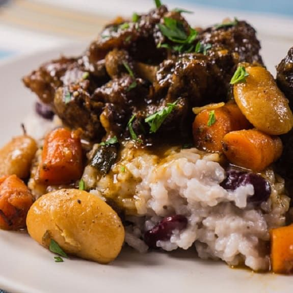 Pressure cooker Jamaican oxtail stew. Beef oxtail pieces with vegetables and spices.
