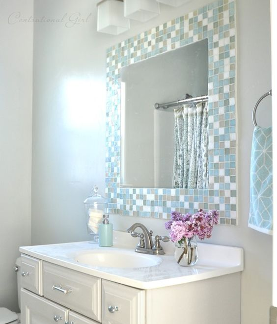 Light grey wall paint with subtle mosaic tile around mirror - then white sink and vanity. Very nice combo for a bathroom!