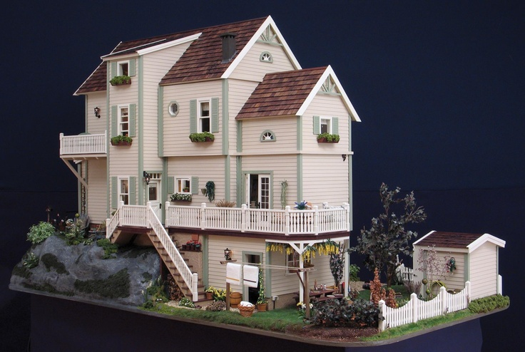 Rear view of dollhouse with wonderful landscaping and exterior details.