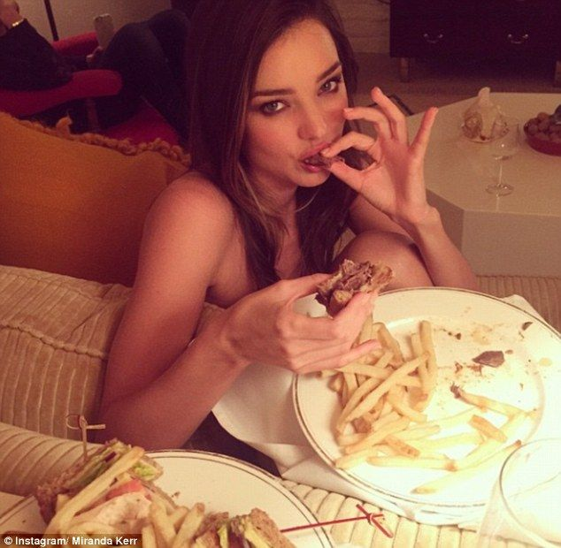 'It's all about balance!' Miranda Kerr showed off her fit figure as she indulged in a burg...