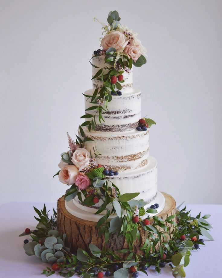 Semi Cake With Cascading Foliage Berries And Fresh Flowers Couture Ni