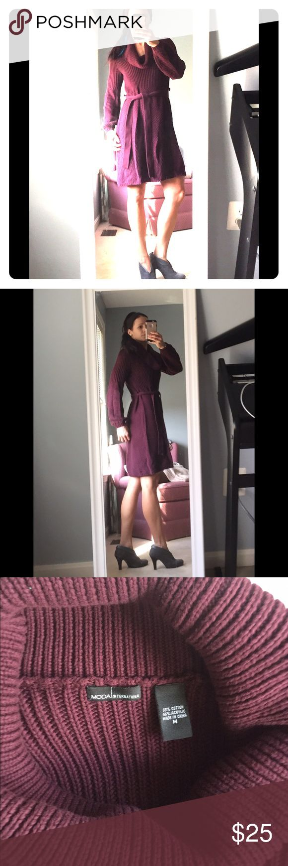 Burgundy sweater dress. Cozy sweater dress with tie around waist and a cowl neck.  The sleeves have a slight bell shape to them. Very warm!  Would look great with knee high boots! The brand is Moda bought from Victoria's Secret. Victoria's Secret Dresses Long Sleeve
