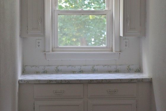 I've been wanting to do something with my ugly counter tops, This lady covered hers with contact paper. A lot cheaper than the other options I looked at.