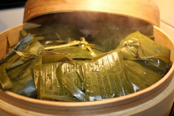 Rice tamales-Filipino tamales. I used to have a friend who would make these, but I only remember the chicken and the egg inside. They were amazing.