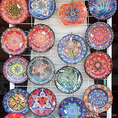 Some colorful greek plates on a wall